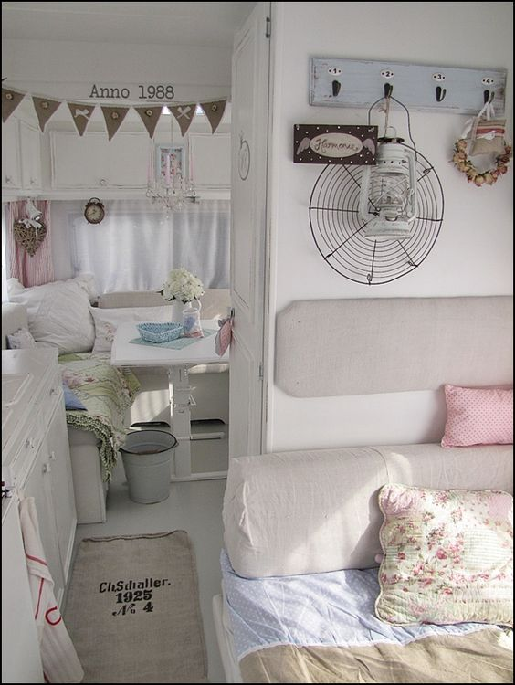 Inside a girly airy trailer. I like how bright it is... but white floors and cushions for camping? Probably not the best for how messy I am