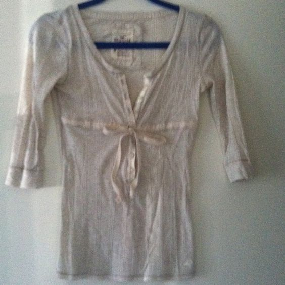 Oatmeal baby doll top Oatmeal color babydoll too. 7 buttons ties at waist, 3/4 sleeve. Hollister Tops