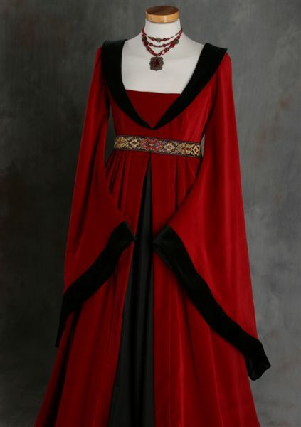 One  of Mierthe's dresses. She wears it when she leaves the Temple - a gift from her aunt. When Mierthe is brought back from captivity she has no wardrobe so her aunt makes a few garments along with the Temple robes that she is given. The Red symbolizes that she is a guardian and the black symbolizes the conflict still within her about becoming a guardian