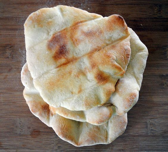 Home Made Pita Bread - I actually just finished making this and the taste is GREAT.. the puffiness is something that I guess will come with experience...YUM!