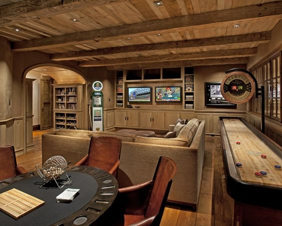 This is definitely a rustic style game room with wood ceiling and floors as well as wood accents and old style games. You'll love playing anything here and bringing all your friends over too.