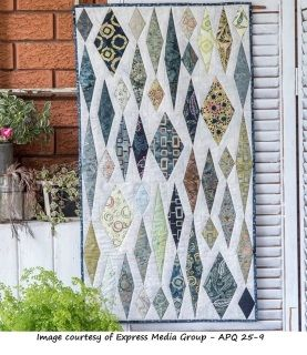 Foundation piecing is used in this quilt to achieve the lovely precise points on the diamonds.  Earth tone batik prints are then embellished using simple stitches to accentuate some of the print.  This little wall hanging measures 20 x 36""