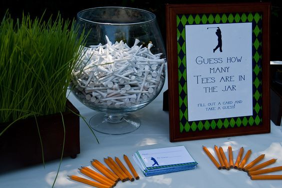 """As guests arrived they were asked to guess the number of golf tees in the bowl with a chance to win the coveted """"Par-Tee Tournament Trophy.""""  The closest guess was 744 with the actual number being 729 (as his birthday is July 29th – clever, huh?)"""