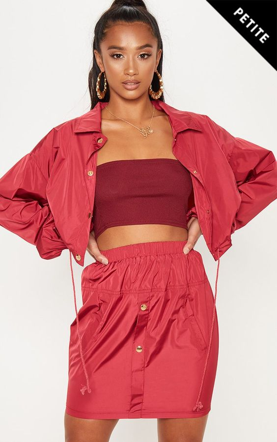 Petite Burgundy Shell Suit Mini SkirtHey doll this skirt is cute AF, featuring an elasticated wai...