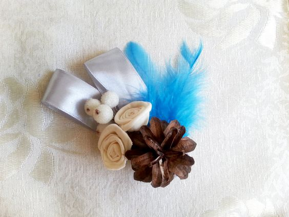 Winter wedding frozen wonderland boutonniere/corsage Cream Flowers, pine cones, feathers, frozen fruits, sola roses, blue - pinned by pin4etsy.com