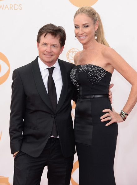 #emmyfashion Actors Michael J. Fox and Tracy Pollan arrive at the 65th Annual Primetime Emmy Awards held at Nokia Theatre L.A. Live on September 22, 2013 in Los Angeles, California.
