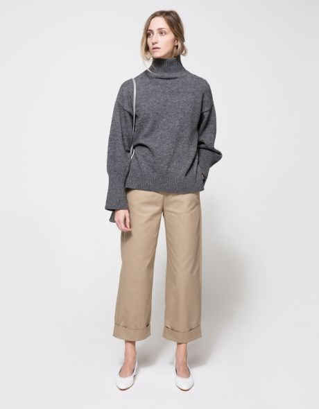From Stelen, a lightweight knit sweater in Charcoal with classic styling.  Features tall neckline, ribbed neckline, dropped shoulders, full length sleeves, wide sleeves, wide ribbed cuff, ribbed hem, side hem slits and relaxed fit.  •Lightweight knit s