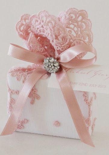 A lovely pink, vintage style, scalloped lace doily, is tied together with satin ribbon, and finished with a diamante button cluster ~ Makes for a beautiful package~❥