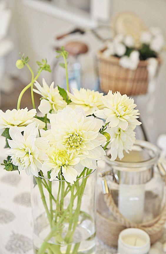 a tablescape, a finger, lovely dahlias