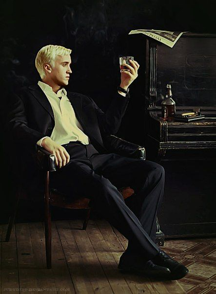 """I've seen this photo many times before, and I've always said, """"cool photo of Draco contemplating life over a fire whiskey"""" or """"nice Tom Felton jack Daniels ad"""" but now I'm like, """"it's Erich Blunt! He's totally the killer."""""""