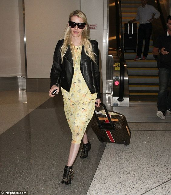 Happy landing: Emma Roberts flew into LAX from the New Orleans set of her new series Screa...