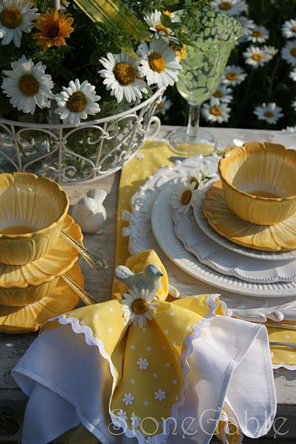 lovely spring table setting. Using different color dishes and napkins to spice up a table.