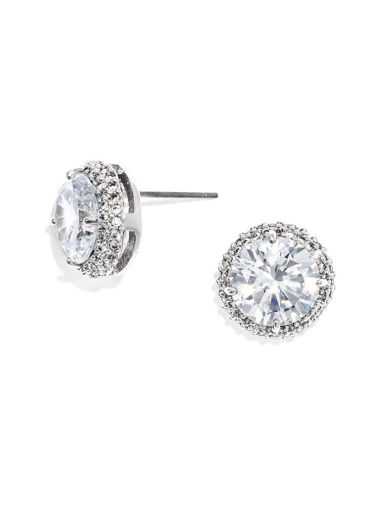 The perfect statement stud will add the proper amount of sparkle without taking attention away from a statement headpiece or necklace. The answer: These large sterling silver and Cubic Zirconia studs complete with settings for an added textural element.