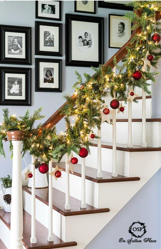 Using different shapes and sizes, add ornaments to your Christmas banister.