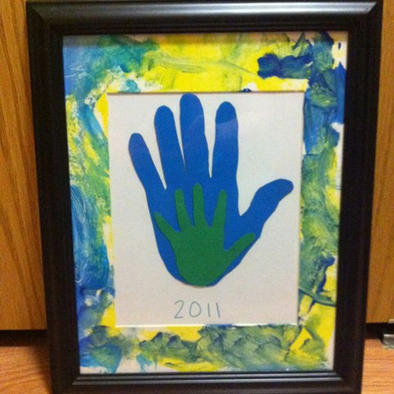 Christmas Gift made for my son's great grandfather. I trace grandpa's hand print and my son's handprint. Then my son painted matte. It was a very successful gift!