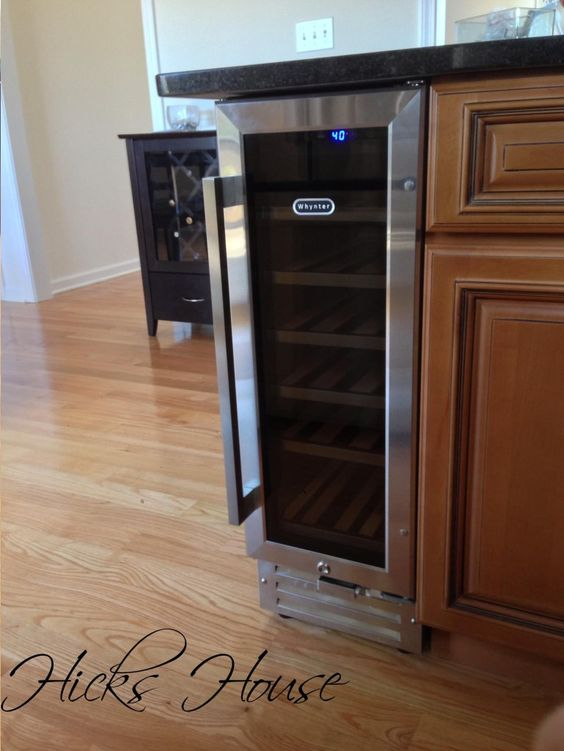 built-in wine fridge, I like how itu0027s on the end cap and small