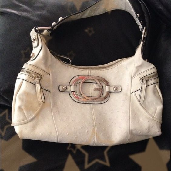 "Guess White handbag Handbag White leather in good condition. Details in silver. Two small pockets on the sides. Dimensions 13.7""x9"" inches Guess Bags"