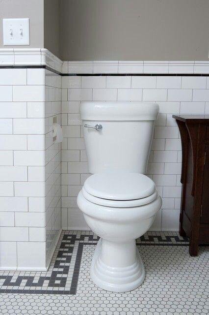 Built in tp holder, white subway tile with wood vanity