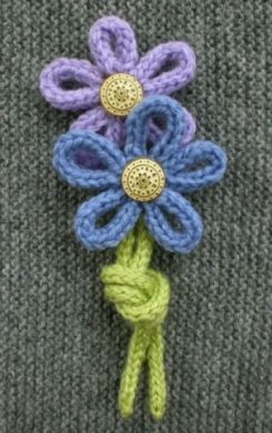 Simple and cute knit flowers.  Could be a cute addition to a shirt.