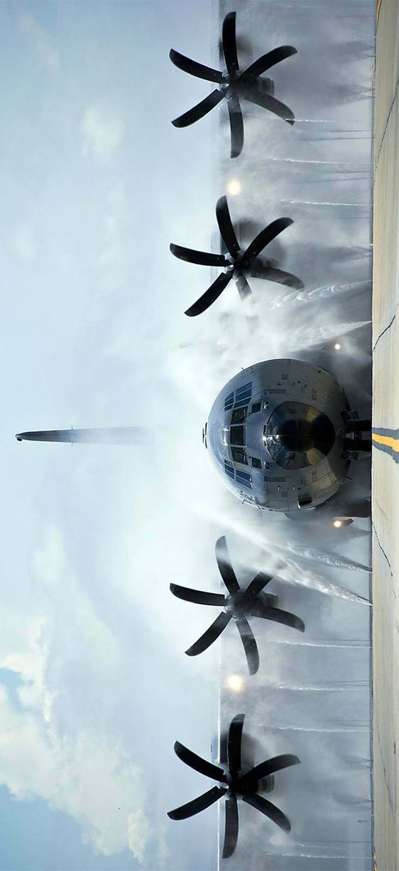 Going through the Plane Wash - Cleaning the salt accumulated on a US Air Force Lockheed Martin WC-130 Hercules after flying through storms over the Gulf of Mexico.