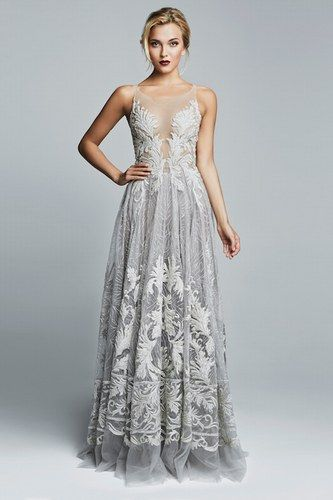 This is certainly a wedding dress with a difference. We love the cool grey with white appliqué lace, especially for a modern winter wedding