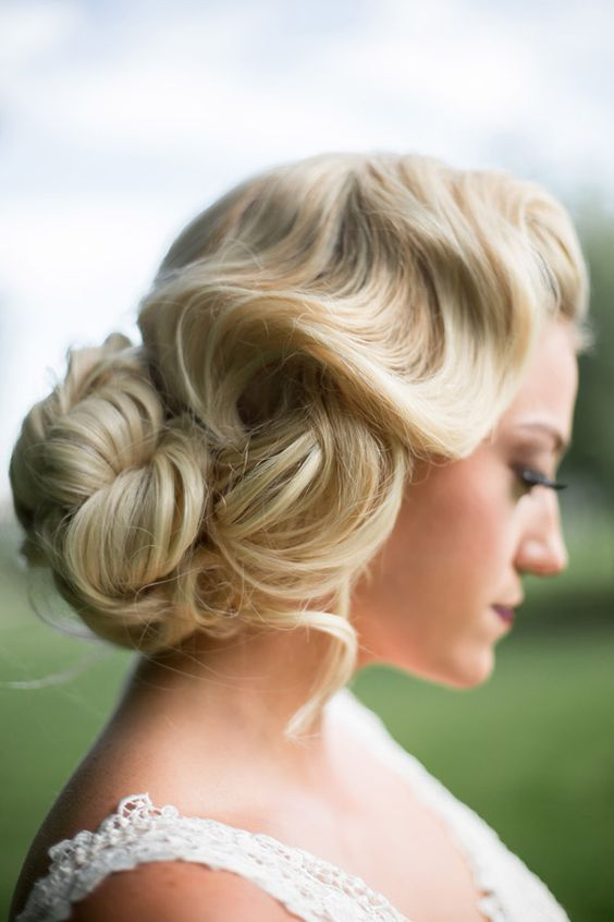 A classic bridal hair look mimicking old Hollywood glamor. Hair is waved and pinned into a bun. Discover how Vênsette can craft custom beauty looks for your special moment: http://vensette.com/bridal_inquiries: