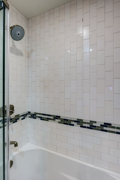 Innovative  Open Shower Concept Is An Excellent Way To Use A Large Bathroom Space
