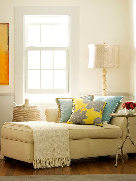 corner retreat with a chaise lounge, good lighting, and soft pillows.
