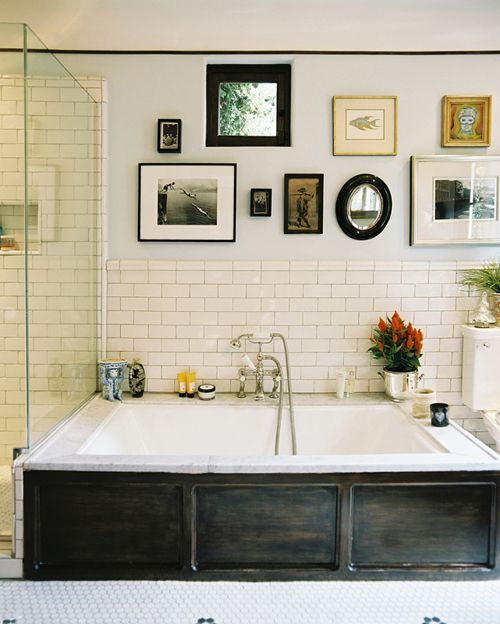 The bathrooms in my dream home would include:  • tiled walls  • a collection of vintage art  • claw-foot tubs  • rain head showers  • my favorite bath products and candles