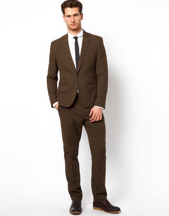 Slim fit dark brown suit. Maybe not quite that slim in the legs