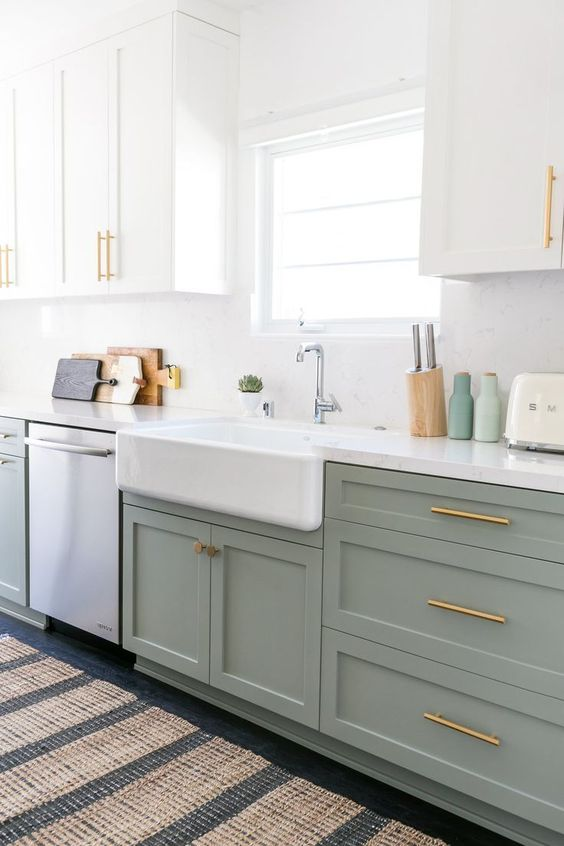 seafoam green and white kitchen design // gold and brass hardware // farmhouse sink // white cabinets