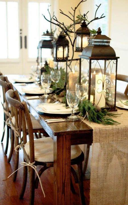 centros de mesa estilo casa de campo con farolillos velas y mucho verde