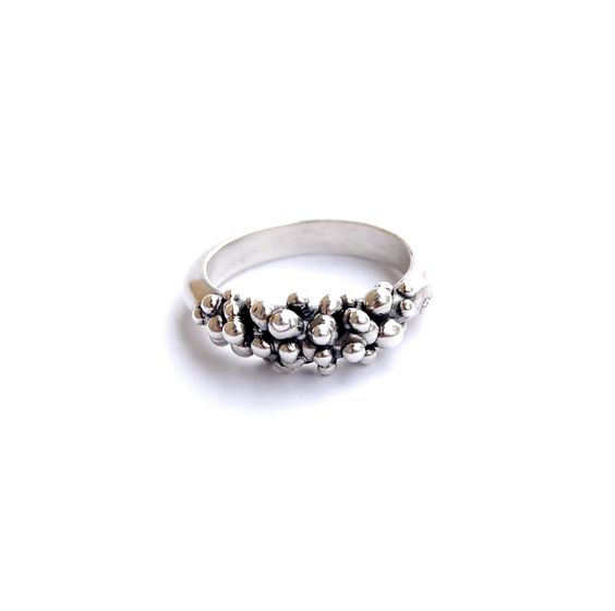 Hand carved and cast sterling silver ring. Available in sizes 4-9. Made in Italy.