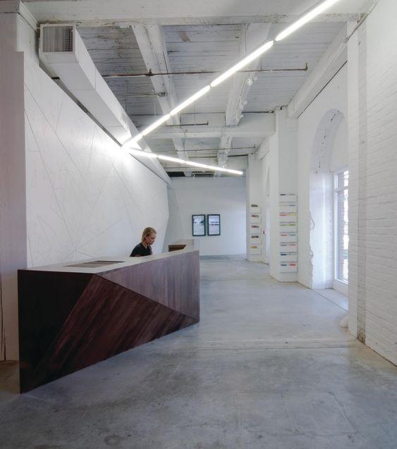 Reception desk warehouse loft type space design decor for Office design dezeen
