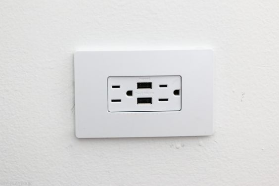 Changing out beige outlets to white.