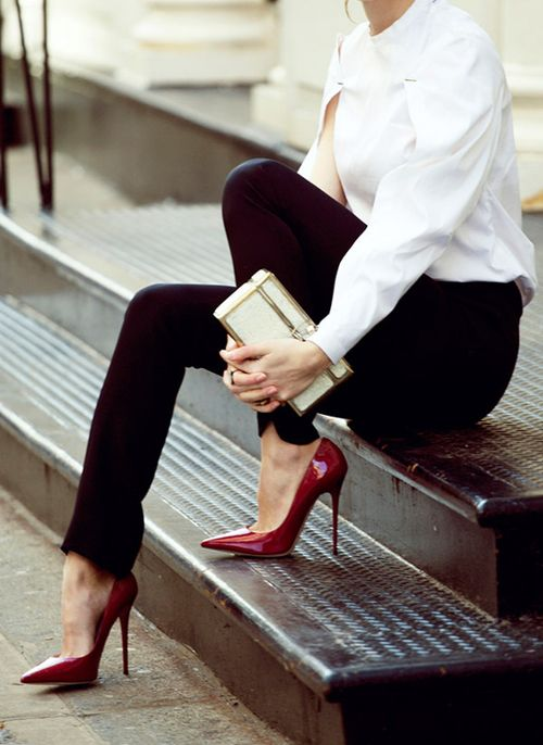 Classic and classy. White blouse, black pants, clutch. Tucked.: