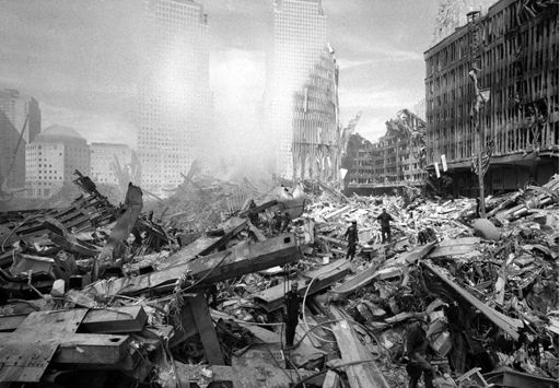 """When Botte was asked to pick which one of his images he would want people to see when they learned about 9/11, he selected the photograph to the left. """"It has a visual impact that to this day, when I stare at it, I just don't take my eyes off it,"""" Botte said.  Credit: John Botte"""