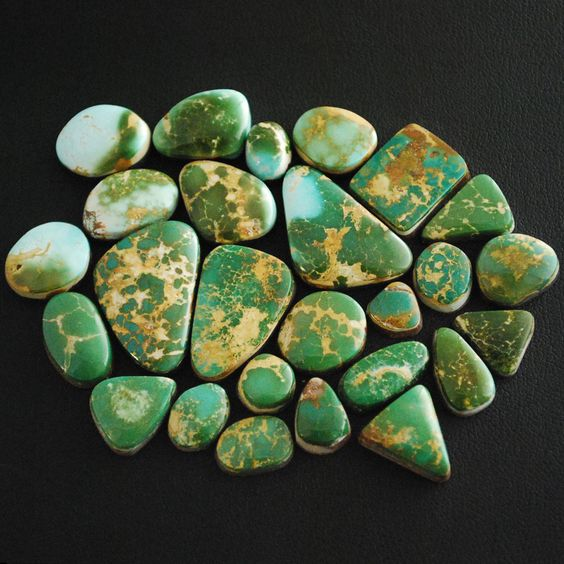 """King's Manassa Turquoise Mine cabochons. This mine is also called """"Lick Skillet"""" turquoise. Manassa turquoise is known for its blue-green to green color with a golden or brown, non-webbed matrix. The golden matrix comes from the host rock, rhyolite."""