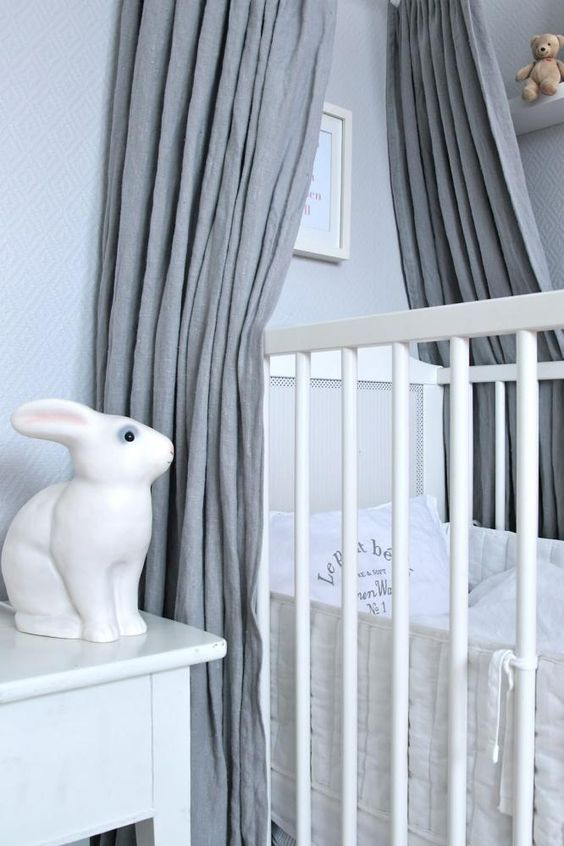 Bunny lamp in nursery. Cradle with canopy.