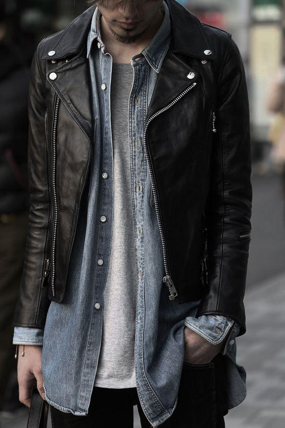 Gray tee under a denim shirt under a leather jacket.