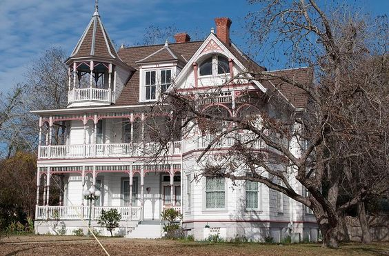 Victorian house with wrap-around porches on two levels, a turret, gorgeous eaves, and bay windows. Where is this place? I want to move in immediately.