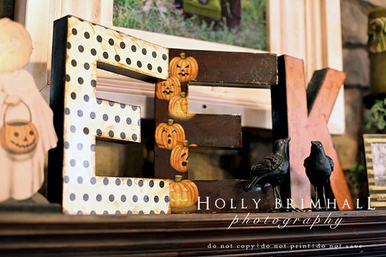 This would be cute to make with letters from craft store and halloween scrapbook paper
