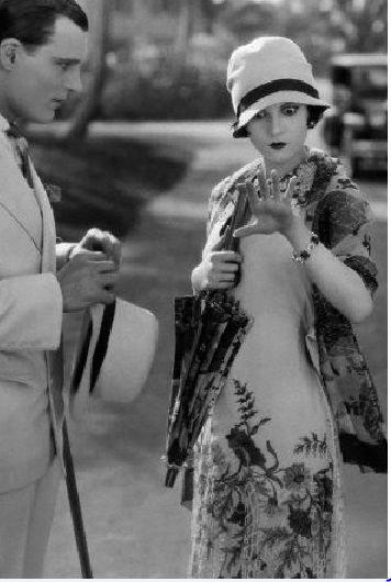 1920's. The dress reminds me of Valentino's fashion
