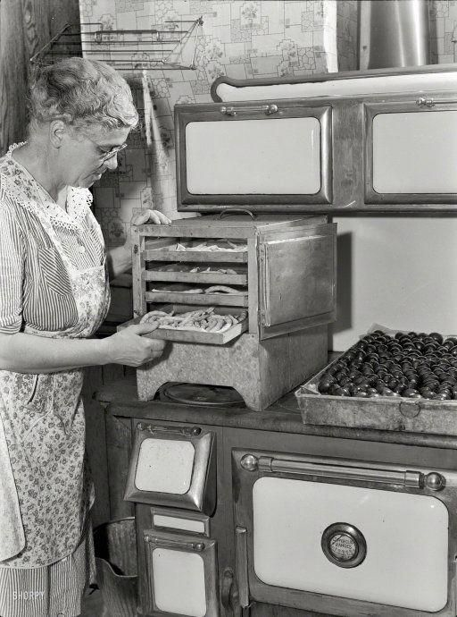 A Old Oregon woman at work in the kitchen many years ago. She developed a new cookbook that was so great , she made her first million dollars by 1960
