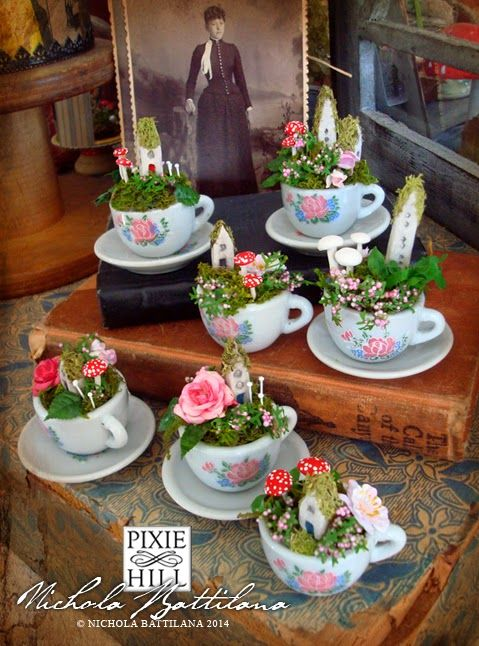 Tiny tea cups and saucers with little flowers, mossy cottages and handmade toadstools. By Nichola Battilana of Pixie Hill blog.