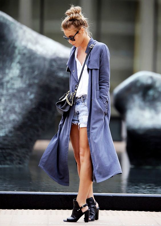 Happily Grey blogger wears a light blue duster coat and cut-out ankle boots: