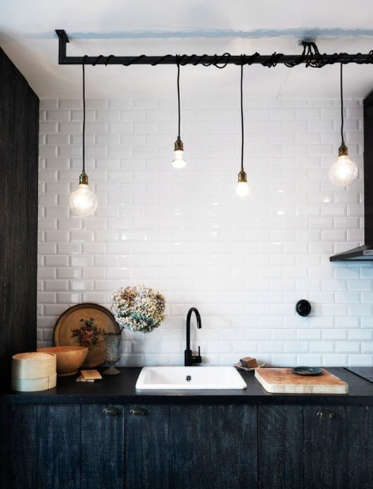 Add Lighting To Your Kitchen With Hanging Light Bulbs. Paired With White  Subway Tile And Black Cabinets, The Kitchen Gets A Chic, Industrial Look.