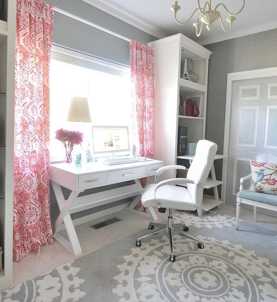 Desk under window, skinny bookshelves on each side, love everything but the pink curtains