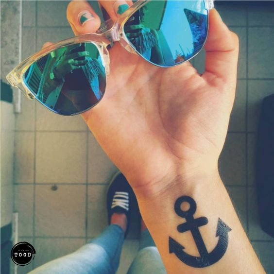 Simple anchor temporary tattoo sticker on wrist