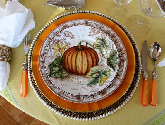 Thanksgiving table setting featuring the Williams-Sonoma Plymouth Collection, orange charger by Anna Weatherley, Calasio beaded placemat & Napoleon flatware by Horchow @calaisio